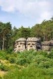 Piaskowiec skała rzeźbi diabeł głowy blisko Zelizy, republika czech obraz stock