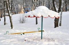 Piaskownica i huśtawka w zimie Zdjęcie Stock
