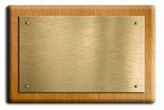 Piastra di legno con oro o la zolla d'ottone Fotografia Stock