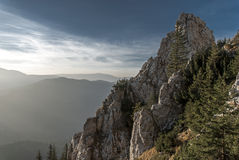 Piatra Craiului mountain ridge at sunset. With pastel clouds at the horizon Royalty Free Stock Images