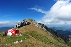 Piatra Craiului mountains - La Om peak shelter. View over the following edge from La Om peak in Piatra Craiului massive and mountain shelter royalty free stock images