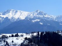 Piatra Craiului mountains from moeciu sirnea Charpatian mountains in the winter. Piatra Craiului mountains from moeciu sirnea Carpathian mountains in the winter stock image