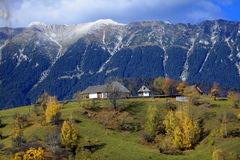 Piatra Craiului Mountains in Romania. Scenic view of Piatra Craiului Mountains with house on green field in foreground, Romania royalty free stock photography