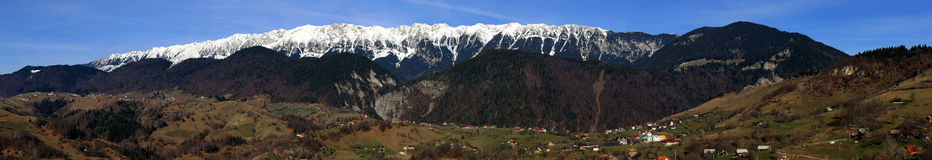 Piatra Craiului Mt panorama. The Piatra Craiului Mountains are a mountain range in the Southern Carpathians in Romania. In Romanian Piatra Craiului means Rock of stock photos