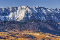 Piatra Craiului National Park, Romania. Landscape with snowy Piatra Craiului mountain ridge in the Piatra Craiului National Park, Brasov county, Romania. Travel royalty free stock image