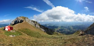 Piatra Craiului panorama - La Om peak shelter. Panoramic view over the green valleys underneath the La Om peak in Piatra Craiului massive royalty free stock images