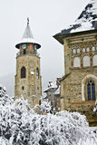 Piatra Neamt city in winter. Stephen the Great Tower and Saint John Church, Piatra Neamt, Romania Stock Photos