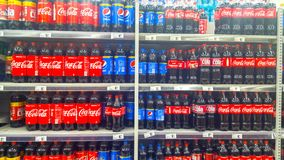 Coca-Cola and Pepsi bottles for sale Stock Image