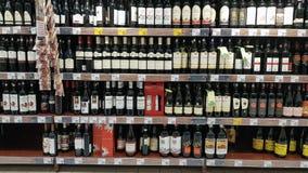 Wine bottles shelf Stock Photos