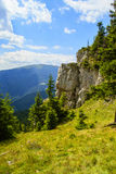 Piatra Soimului-Rarau-Romania. Mountain valley with rocks and green grass on summer day in wilderness romanian carpathians. Piatra Soimului-Rarau-Romania Royalty Free Stock Images