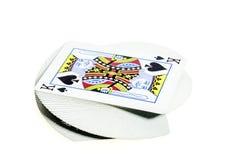 Piattaforma delle carte con un re sulla cima Immagine Stock Libera da Diritti