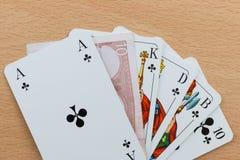Piattaforma delle carte della mazza con l'euro nota Fotografia Stock