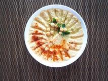 Piatti dei ceci hummus Cucina del Medio-Oriente magra fotografie stock libere da diritti
