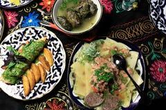 Piatti del cittadino dell'Uzbeco Immagine Stock