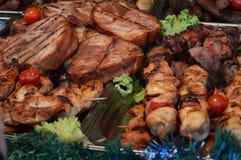Piatti della carne di maiale e griglia del barbecue Fotografia Stock Libera da Diritti
