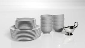 Piatti della cucina; piatti, ciotole e piatto della salsa su fondo bianco Fotografie Stock Libere da Diritti