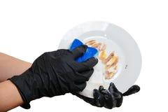 Piatti di lavaggio i piatti puliscono il lavaggio con una spugna Fotografia Stock