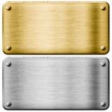 Piatti di metallo d'argento dell'oro e dell'acciaio Fotografia Stock Libera da Diritti