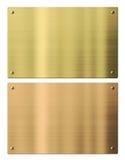 Piatti di metallo dell'oro e del bronzo isolati con Fotografie Stock Libere da Diritti