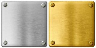 Piatti di metallo dell'oro e dell'argento con il percorso di ritaglio Fotografia Stock Libera da Diritti