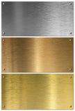Piatti di metallo dorati, d'argento e di rame messi Immagine Stock Libera da Diritti
