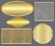 Piatti di oro su un metallo Immagini Stock Libere da Diritti