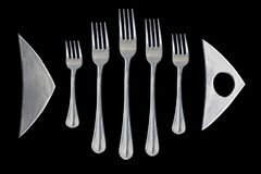 Piatti di pesce pesce dalle forcelle Logo su fondo nero Immagini Stock Libere da Diritti