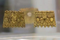 Piatti dorati di scorta di Martela della La datati alle seconde età del ferro fotografie stock