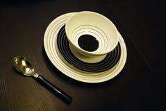 Piatti e cucchiaio Fotografia Stock