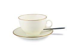 Piattino e cucchiaino da tè della tazza Immagine Stock