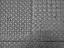Piatto in bianco e nero alto chiuso dei diamanti della lamina di metallo Fotografia Stock