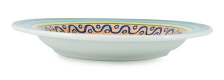 Piatto ceramico isolato su un fondo bianco Immagini Stock