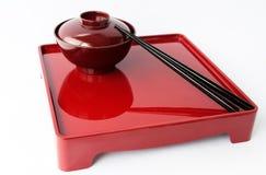 Piatto cinese e bastoncini Immagini Stock