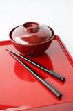 Piatto cinese e bastoncini Immagine Stock