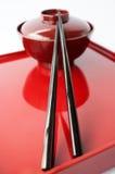 Piatto cinese e bastoncini Fotografia Stock