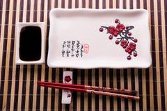 Piatto con i bastoncini per i sushi Fotografia Stock Libera da Diritti