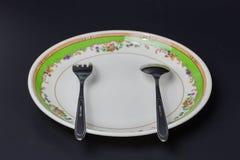 Piatto con il cucchiaio e la forchetta inossidabili Immagini Stock Libere da Diritti