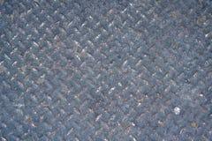 Piatto d'acciaio verde arrugginito del diamante, struttura del fondo Fotografia Stock