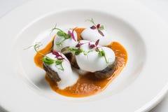 Piatto d'annata con i ravioli casalinghi neri salati Fotografie Stock Libere da Diritti