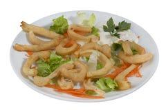 Piatto dei calamari fritti deliziosi Fotografia Stock Libera da Diritti