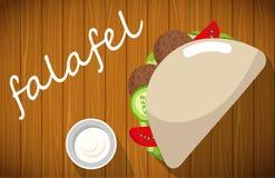 Piatto del falafel con il pane della pita sulla tavola di legno Immagini Stock Libere da Diritti