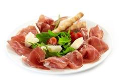 Piatto del prosciutto di Parma e del parmigiano Fotografia Stock Libera da Diritti