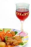 Piatto della carne con un vetro rosso Fotografia Stock