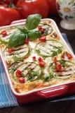 Piatto di moussaka con lo zucchini ed il peperoncino Fotografie Stock Libere da Diritti