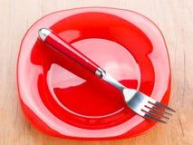 Piatto e forcella, rosso luminoso e luminoso moderni Fotografia Stock