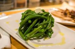 Piatto gastronomico laterale cucinato dei fagiolini Fotografia Stock