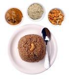 Piatto indiano del riso con la mascherina di residuo della potatura meccanica immagini stock