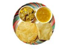 Piatto indiano - Puri con il curry di agnello e del dal Immagini Stock