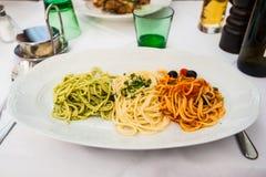 Piatto italiano con tre generi di pasta fotografia stock libera da diritti