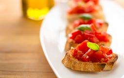 Piatto italiano di bruschetta immagine stock